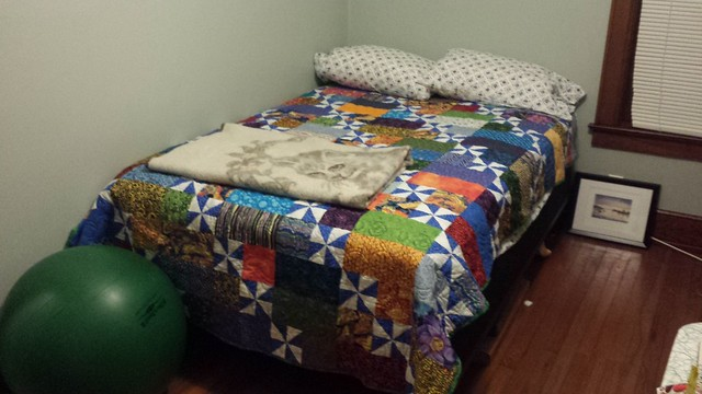 Well-decorated guest bed