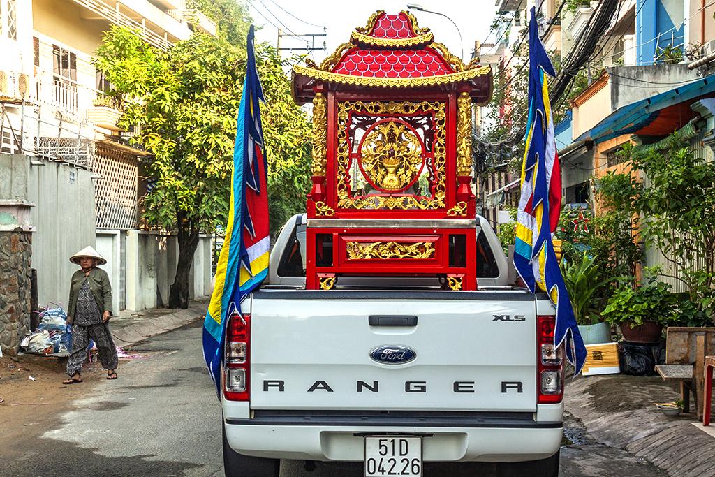 Lead car in a funeral procession--Saigon