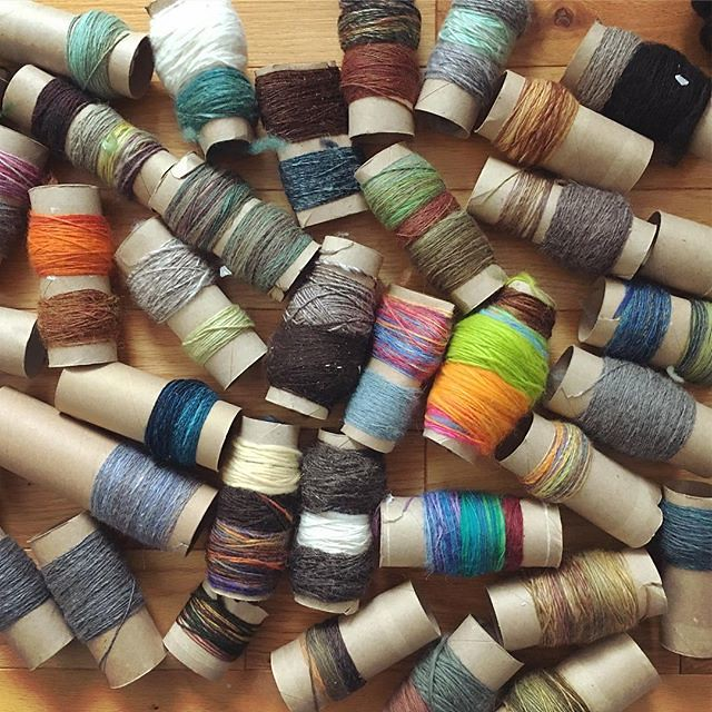 Sunday project: years of bobbin leftover single-plies from spinning. Will spin into random three ply. 🌀 #spinning