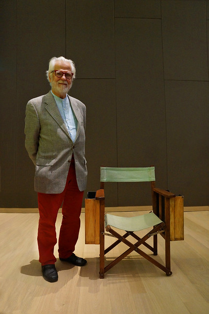 The Establishing Shot : STANLEY KUBRICK: THE EXHIBITION & THE DESIGN MUSEUM 2019 EXHIBITION PROGRAMME ANNOUNCEMENT - JAN HARLAN, KUBRICK PRODUCER & BROTHER IN-LAW KINDLY POSES ALONGSIDE STANLEY KUBRICK'S DIRECTORS CHAIR - DESIGN MUSEUM, LONDON