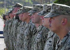 Seabees from Naval Mobile Construction Battalion (NMCB) 3 stand at parade rest during a Relief in Place/Transfer of Authority ceremony at Camp Shields, Oct. 22. (U.S. Navy/MC2 Michael Lopez)