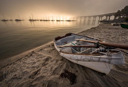 california san diego sandiego coronado bridge sunrise sunset beach photography mikeoria mikeoriaphotography pentax k3ii sigma 816 8mm gps dinghy boat rowboat oars sun light sand sailboat corobadobridge tidelands park landscape seascape
