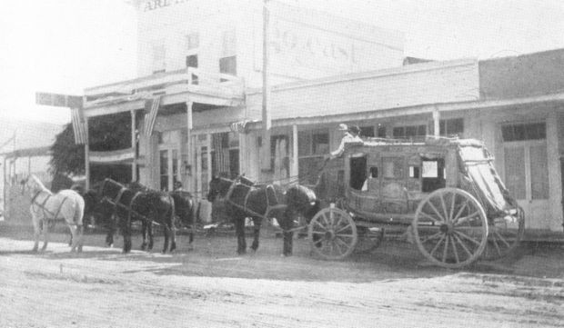 A Kinnear Express stagecoach operating from Tombstone to Bisbee in the 1880s. This thoroughbrace stage used thick leather straps to support the body of the carriage and serve as shock absorbing springs.