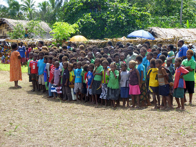 Children organised  in a group ready to sing at a John Frum festival in middlebush, Tanna Island