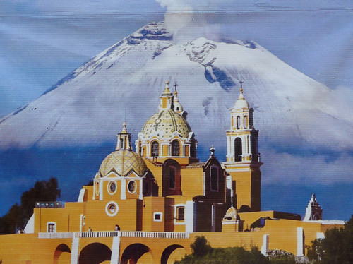 Al's photo of the advertising of the church with the volcano looming over it in Cholula, Mexico