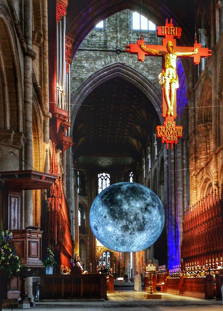 The moon floating through Peterborough cathedral