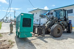 TINIAN, Northern Mariana Islands (Nov. 1, 2018) Sailors assigned to Naval Mobile Construction Battalion 1 place an emergency power generator at a de-energized location during recovery operations following Typhoon Yutu. Service members from Joint Region Marianas and Indo-Pacific Command are providing Department of Defense support to the Commonwealth of the Northern Mariana Islands' civil and local officials as part of the FEMA-supported Typhoon Yutu recovery efforts. (U.S. Navy photo by Chief Mass Communication Specialist Matthew R. White /released)
