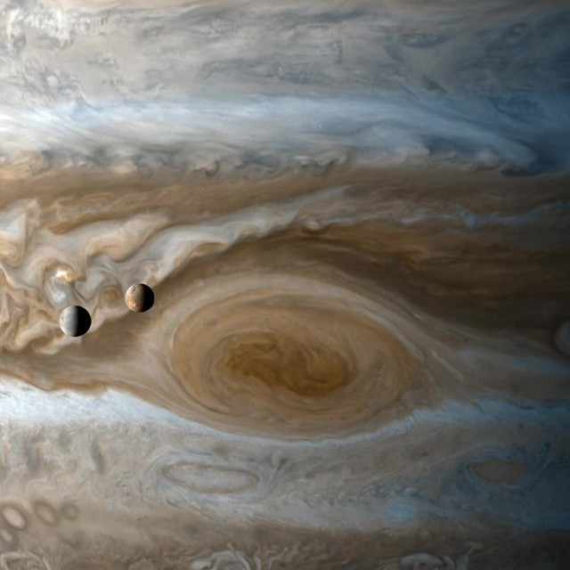Created using still images taken by the Cassini spacecraft during it's flyby of Jupiter and while at Saturn. Shown is Io and Europa over Jupiter's Great Red Spot and then Titan as it passes over Saturn and it's edge-on rings.