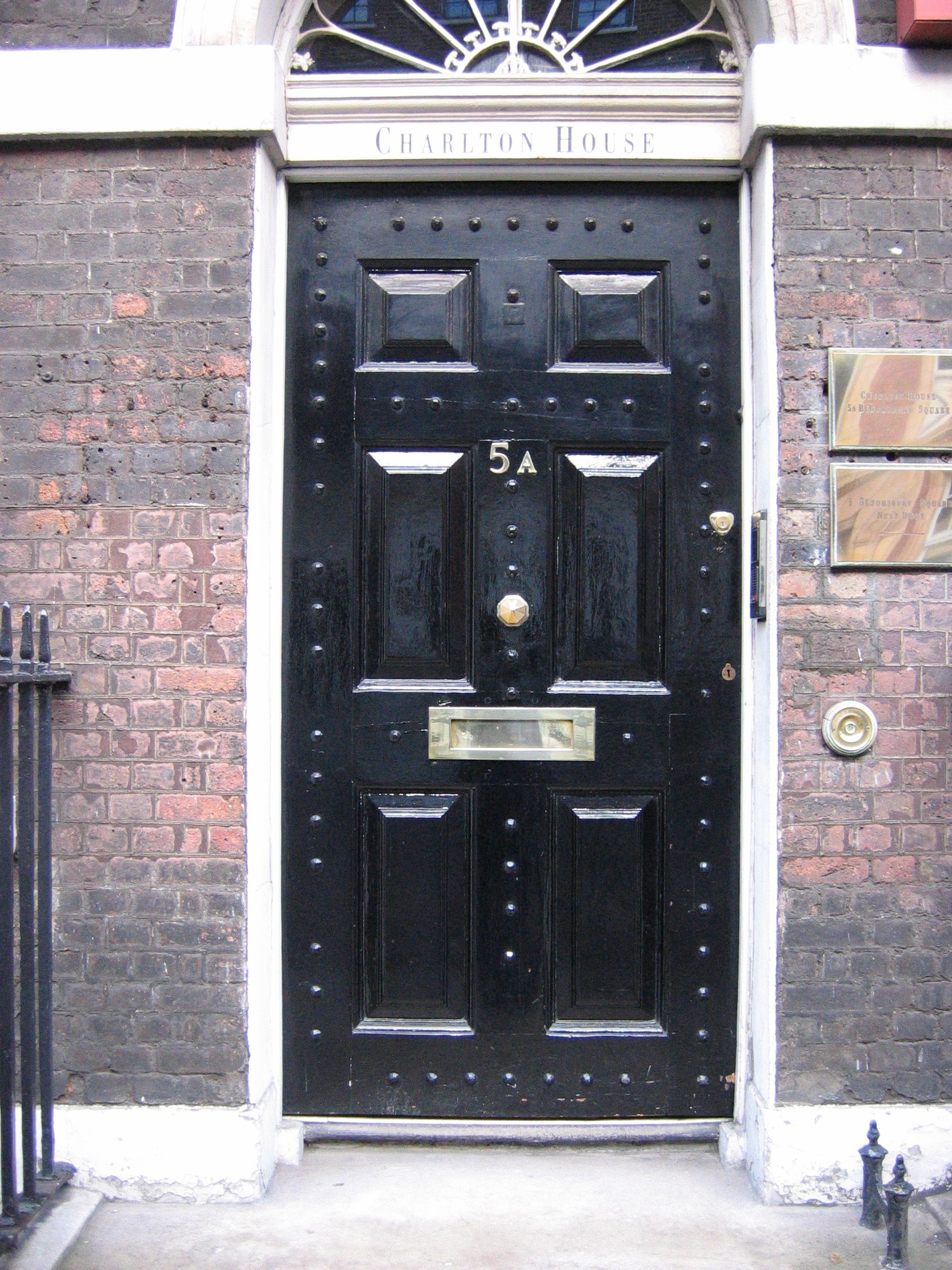 A mail slot letterbox at Charlton House, 5A Bloomsbury Square, London, located in the middle of the front door. Photo taken by Richard Smith on November 28, 2004.