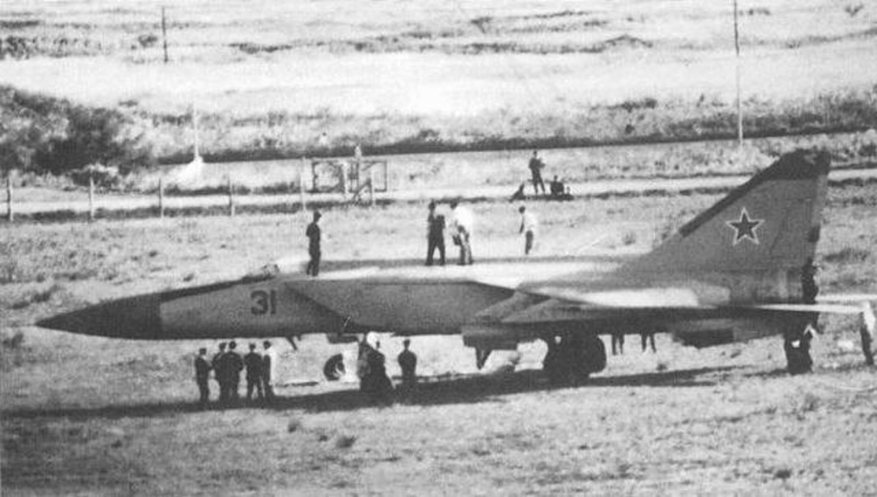 Defected Soviet MiG-25 being inspected by American and Japanese officials, 1976