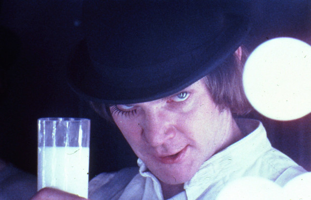 The Establishing Shot™ : A Clockwork Orange, directed by Stanley Kubrick (1970-71; GB/United States). Alex DeLarge (Malcolm McDowell) in the Korova Milkbar. Still image. © Warner Bros. Entertainment Inc.