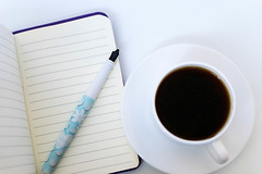 Close Up on The Coffee and Open Notebook With Pen