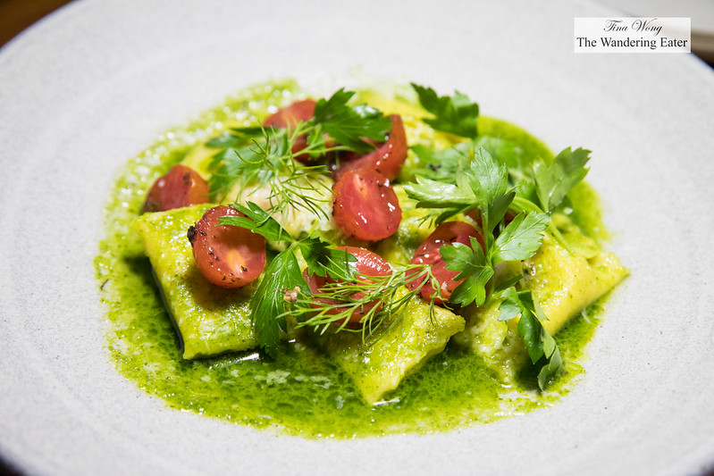 Agnolotti with parsley sauce and tomatoes