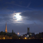 Moon behind clouds over Preston