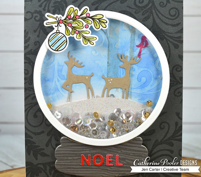 Jen Carter Snow Globe Flourishes Woodgrain Holiday Charms Closeup