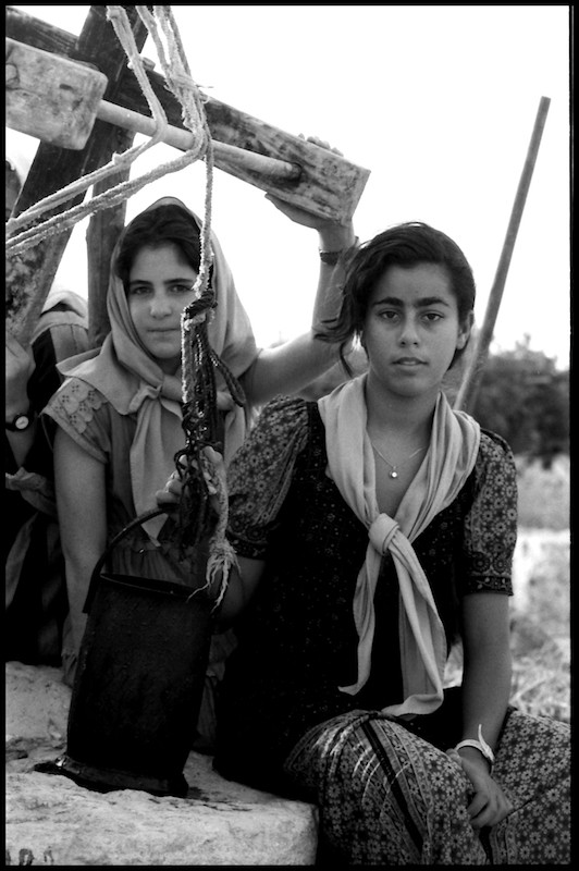 Girls near a well in a reconstructed Hasmonean village,