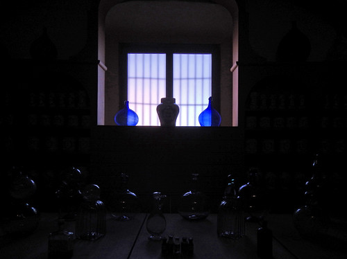 Blue glass vases in a window of a museum displaying glassware in Puebla, Mexico