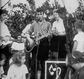 The famous photo of the Quarrymen playing at St. Peter's Church garden fête on July 6, 1957,, where Lennon and McCartney first met. From left to right: Griffiths, Hanton, Davis, Lennon, Shotton, Garry