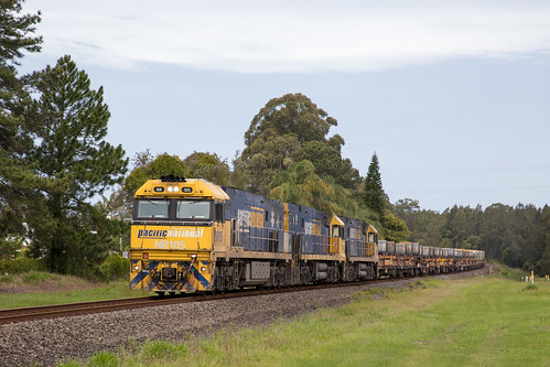 Pacific National NR Class 105/43/16 head 7WB3 departing Urunga