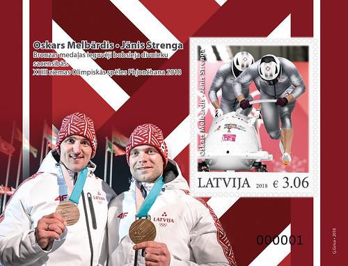 XXIII Ziemas Olimpisko spēļu medaļniekiem veltīts pastmarkas bloks