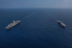PHILIPPINE SEA (Oct. 9, 2018) The aircraft carrier USS Ronald Reagan (CVN 76) and helicopter destroyer JS Izumo (DDH 183) sail alongside each other during a cooperative deployment. Ronald Reagan is forward-deployed to the U.S. 7th fleet area of operations in support of security and stability in the Indo-Pacific region.  (U.S. Navy photo by Mass Communication Specialist 2nd Class Kaila V. Peters)