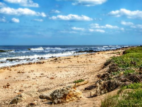 coaralsandaandblueskies marinelandflorida beach ocean atlanticocean sand rocks waves scenic bluesky clouds