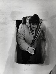 The Rt. Hon. Sir Robert Muldoon emerging from an ice cave in Antarctica, 1982