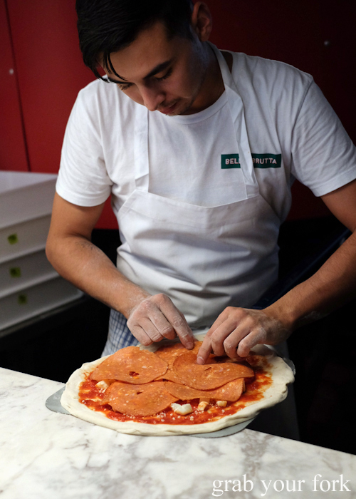 Making up the pepperoni pizza at Bella Brutta Pizza in Newtown