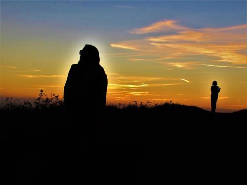 Figures at dusk.