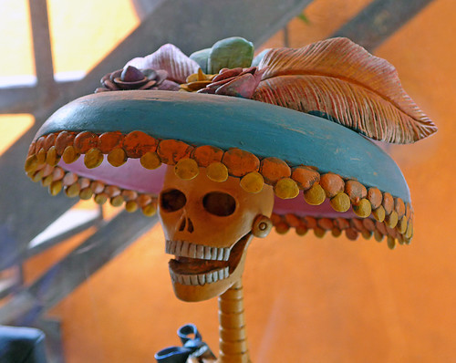 A ceramic skull with a fancy hat in San angel, a suburb of Mexico City