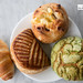 Bacon and cheese cresent roll, apple turnover, matcha melon pan, cranberry cream cheese bread