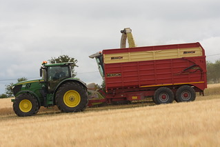 Claas Jaguar 900 SPFH filling a Herron Trailer drawn by a John Deere 6215R Tractor