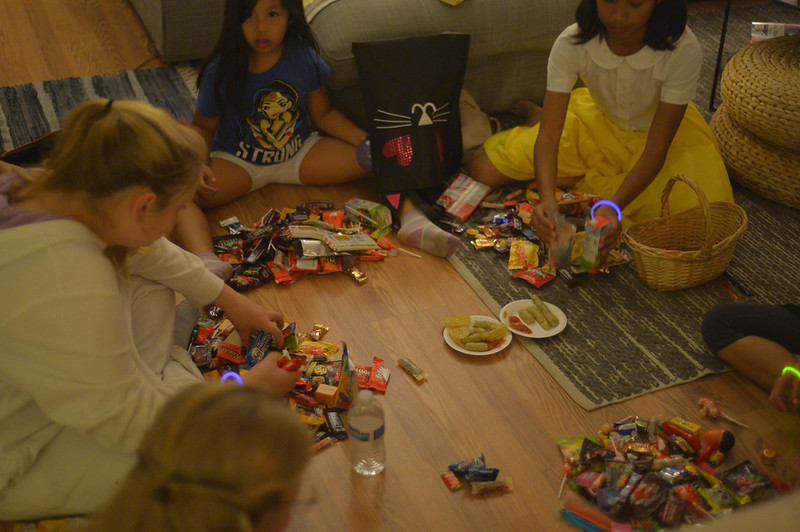 sorting their candy loot