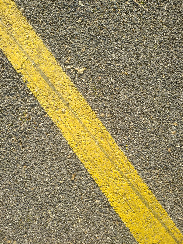 Asphalt texture with yellow sign
