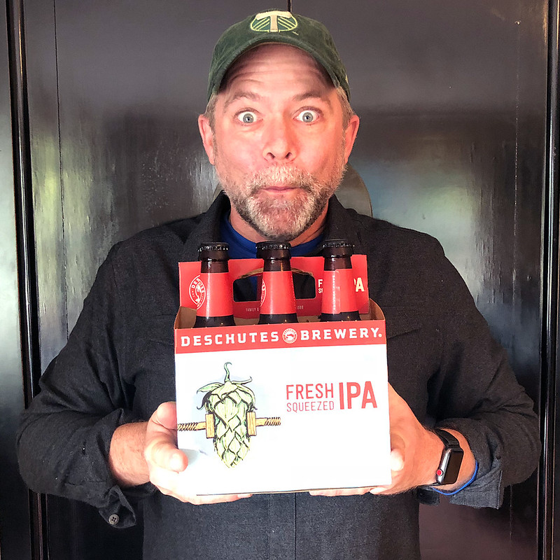 J.D. with a six-pack of his favorite beer