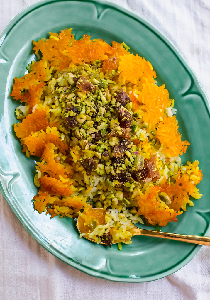 Persian rice with dates, chopped pistachios and aromatic cardamom is steamed together with an additive and crunchy saffron crust called tahdig.