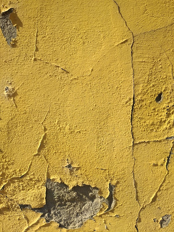 Cracked yellow wall texture