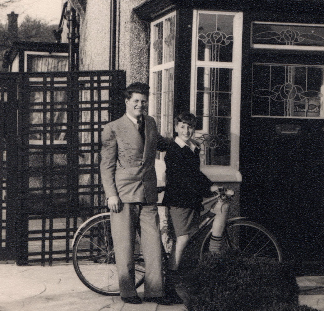 Stanley Parkes (Lennon's older cousin), age 15 and John, age 8 posing in front of Lennon's childhood home. About a year later, Parkes gave John his green Mercury album which he used to collect stamps over the next several years. Photo courtesy of Time/LIFE.