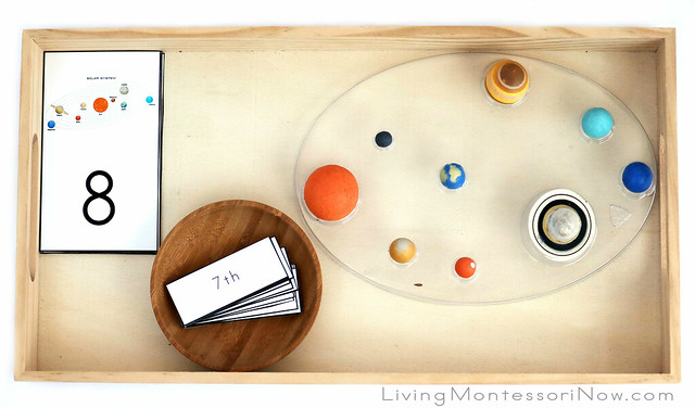 Tray with Solar System Figures, Number Cards, and Labels for Cardinal and Ordinal Numbers