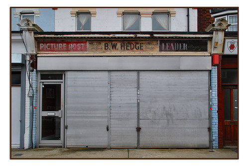 OLD SHOPFRONT SIGN FOR B.W.HEDGE, NEWSAGENTS