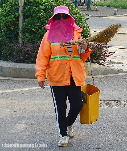 Street sweeping lady