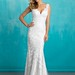 Wedding Dresses  : Delicate rows of lace appliqués cover the fine English net of this slip sheath ...