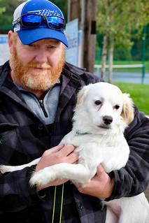 FUJI8222--Wanda's youngest son, Matt holding his son, Christopher's puppy, Teddy.