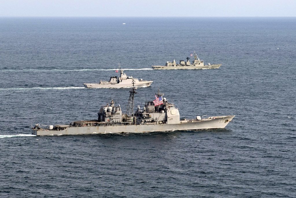 The guided-missile cruiser USS Antietam (CG 54) and Royal Thai Navy ships HTMS Krabi (OPV 551) and HTMS Taksin (FFG 422) conducted a cooperative deployment in the East China Sea on Oct. 9, 2018.