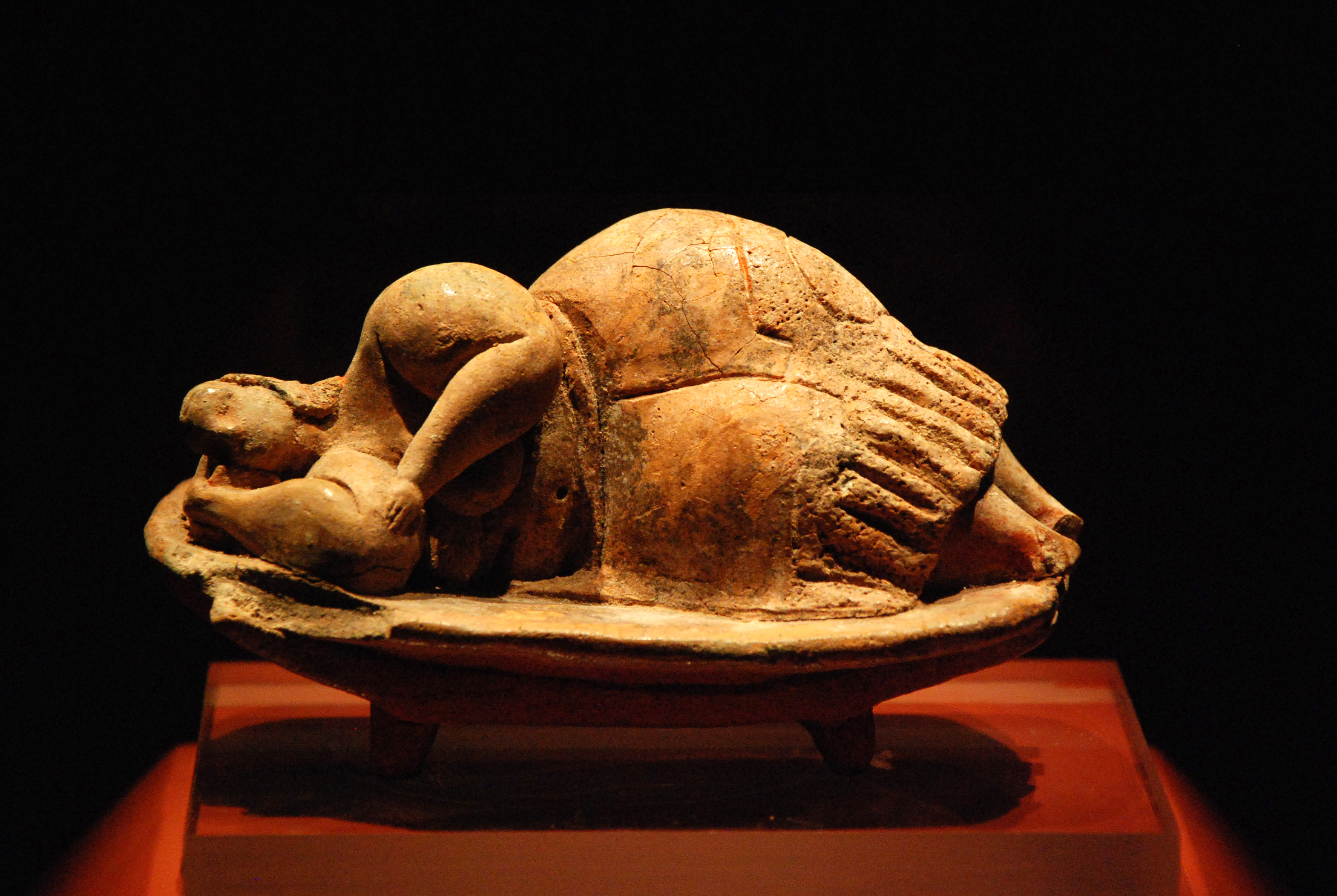 This clay figure of a reclining lady was found in one of the pits of the Hypogeum in Hal Saflieni in Malta. It has traces of red ochre paint and is thought to represent a