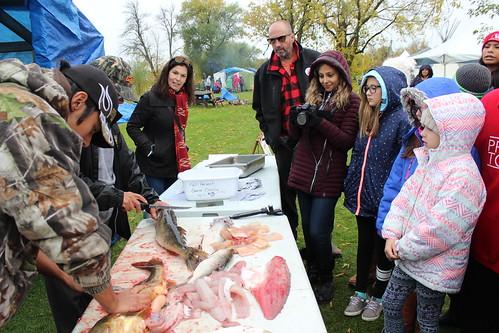 <p>JICS Teacher Carol Stephenson learning how to prepare fish</p>