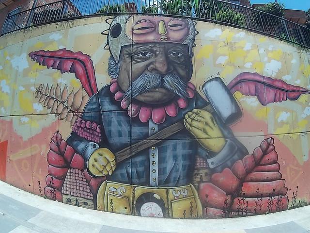 Graffiti con híbrido de currante y dios inca