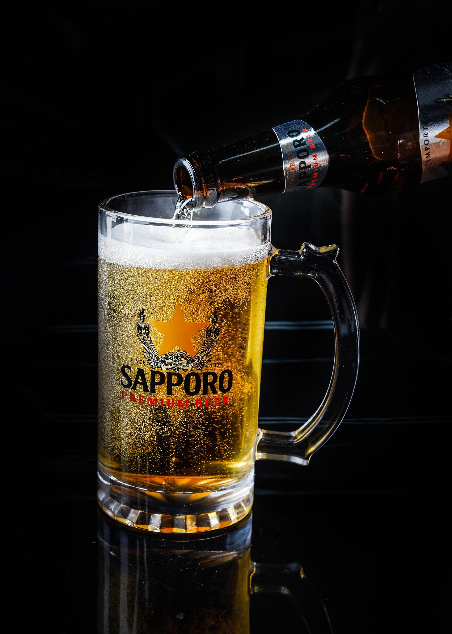 Pouring Sapporo Premium Beer