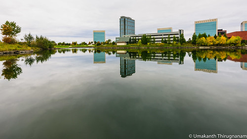 water reflections reflection pond clouds cloudy fall trees architecture buildings kanata ontario ottawa canada cityscape landscape nikonafs1424mmf28ged d810 moody