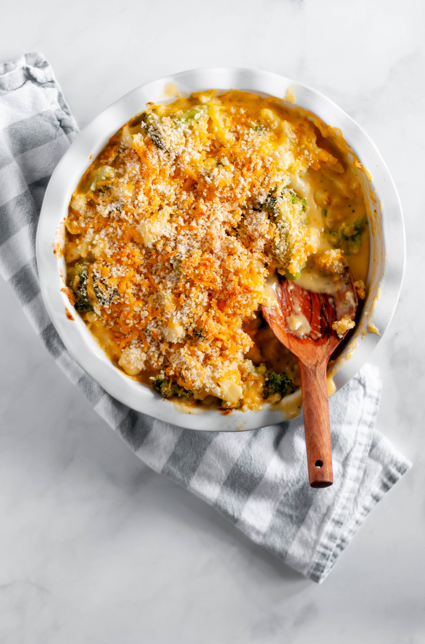 Broccoli and Cauliflower Au Gratin is a favorite side dish for every holiday. Rich, homemade cheese sauce, broccoli and cauliflower with a crispy panko topping.